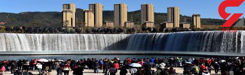 بزرگترین آبشار مصنوعی جهان مورد توجه توریست ها +تصاویر