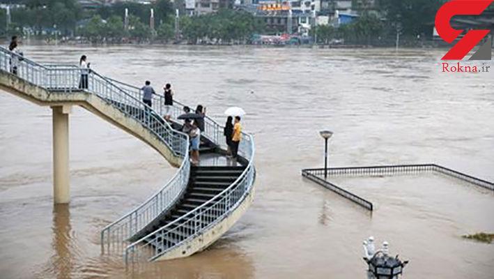 مرگ 15 چینی در بارش سیل آسای باران + تصویر