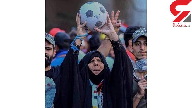 تصویر زن تماشاگر عراقی جهانی شد+ عکس