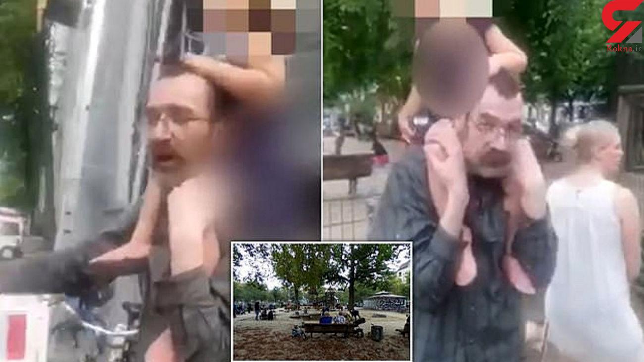 فیلم لحظه ربودن دختر 2 ساله از پارک / مرد عینکی ناگهان دختر را روی شانه هایش گذاشت و با خود برد / آلمان