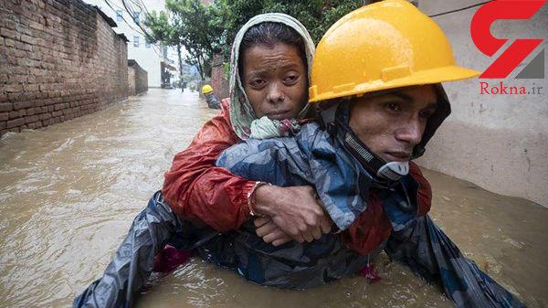30 کشته در پی سیلاب هند+عکس