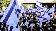 راهپیمای صهیونیست ها با پرچم در سرزمین های اشغالی + عکس