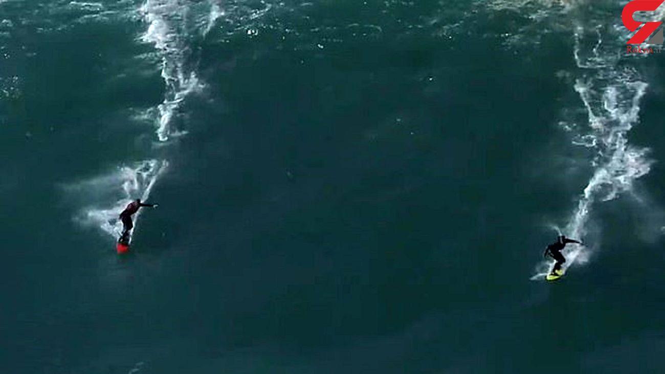 لحظه برخورد شدید دو موج سوار در ساحل پرتغال
