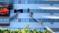 لحظه دلهره آور نجات یک مرد از شعله های آتش برج + فیلم / امریکا