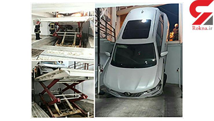 سقوط حادثه ساز خودرو در پارکینگ آپارتمان مسکونی در رشت + عکس