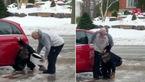تلاش خندهدار یک زن برای حفظ تعادل روی زمین یخزده + فیلم